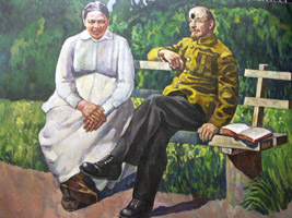 Vladimir Lenin and his wife Nadezhda Krupskaya on a bench, with bullet-hole